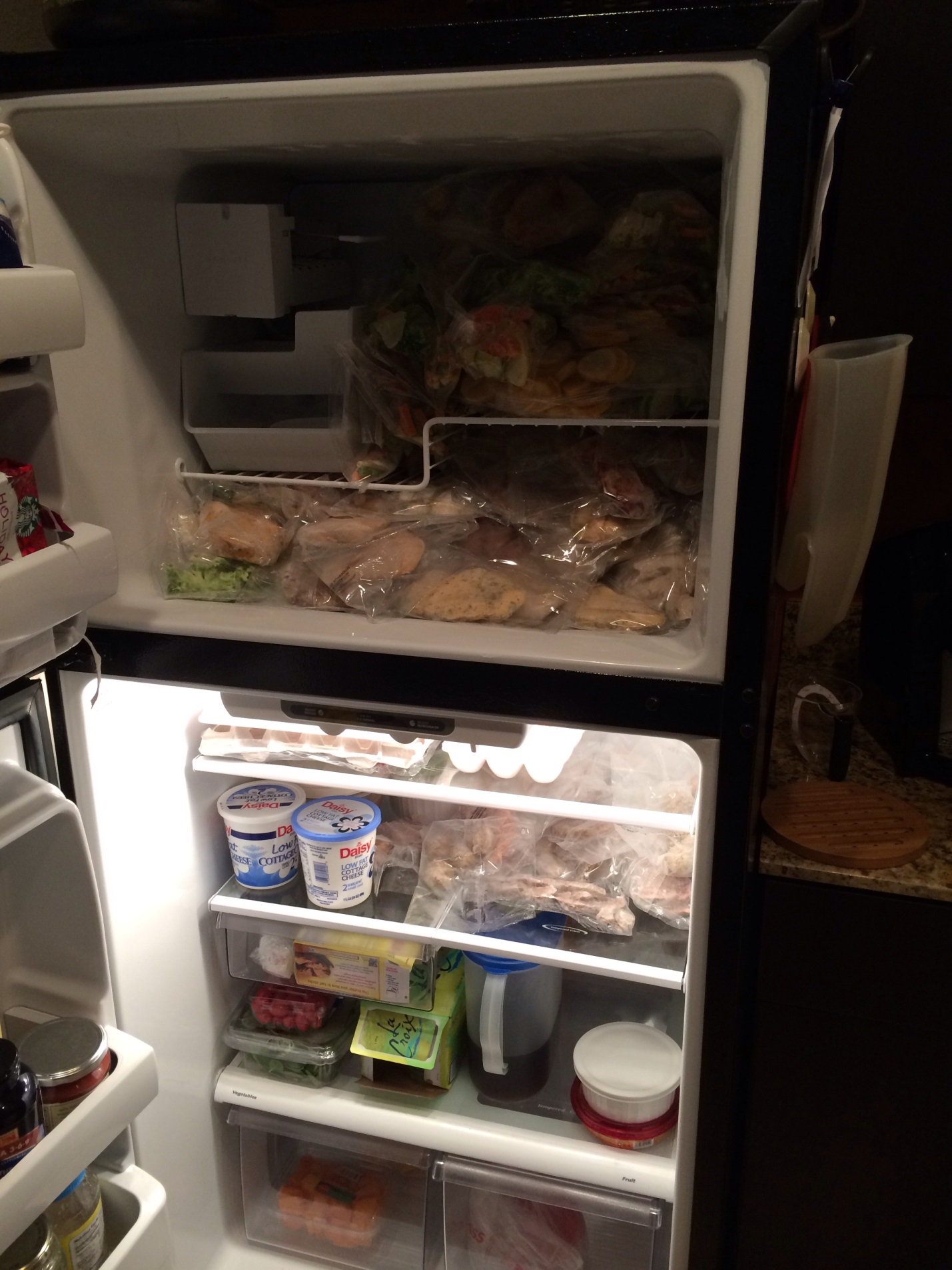 Fridge and Freezer full of food by Fort Worth Financial Planner Hull Financial Planning
